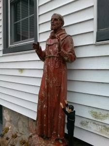 Fr. Kenny tries to get St. Francis' attention.