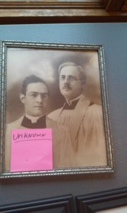 We can't figure out who these gentlemen are, but it seems that the one on the right is wearing a seminarian's collar.