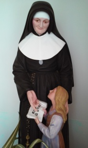 St. Julie teaches a child.
